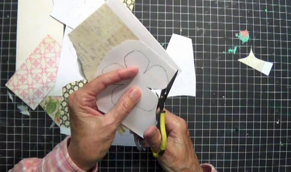 scrapbook paper flowers DIY cutting out layers of flower patterns from paper scraps